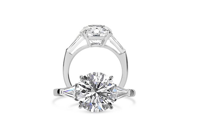 Solitaire diamond ring with tapered baguettes